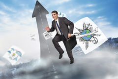 Composite image of cheerful businessman in a hurry Royalty Free Stock Images