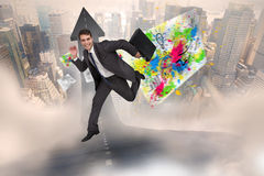 Composite image of cheerful businessman in a hurry Stock Photo
