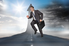 Composite image of cheerful businessman in a hurry Stock Photography
