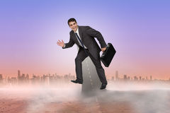Composite image of cheerful businessman in a hurry Stock Image