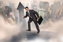 Composite image of cheerful businessman in a hurry Royalty Free Stock Photo