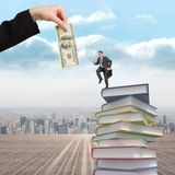 Composite image of cheerful businessman in a hurry. Cheerful businessman in a hurry against stack of books Stock Photos