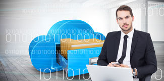 Composite image of cheerful businessman with laptop using smartphone Stock Image