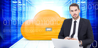 Composite image of cheerful businessman with laptop using smartphone Royalty Free Stock Images