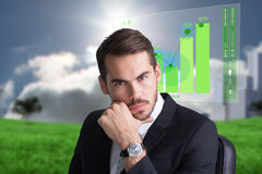 Composite image of cheerful businessman posing with hand on chin Stock Photos