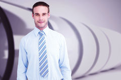 Composite image of cheerful businessman posing with hands in pockets Stock Photos