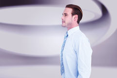 Composite image of cheerful businessman posing with hands in pockets Royalty Free Stock Photos