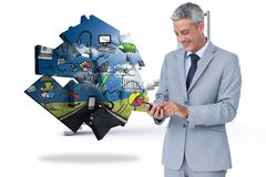 Composite image of cheerful businessman sending text message Royalty Free Stock Photos
