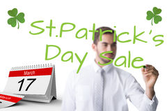 Composite image of cheerful businessman writing with marker Royalty Free Stock Image