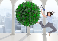 Composite image of cheerful businesswoman jumping while holding megaphone Royalty Free Stock Images