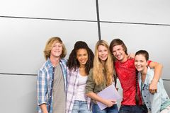 Composite image of cheerful college students in library. Cheerful college students in library against white tiling Royalty Free Stock Photo