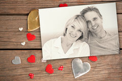Composite image of cheerful couple in bed Stock Photography