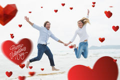 Composite image of cheerful couple holding hands and jumping at beach. Cheerful couple holding hands and jumping at beach against cute valentines message Royalty Free Stock Images