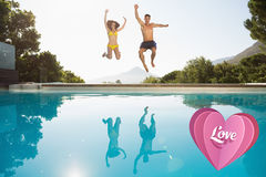 Composite image of cheerful couple jumping into swimming pool Stock Photography