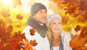 Composite image of cheerful couple in warm clothing Royalty Free Stock Photos