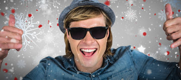 Composite image of cheerful hipster wearing sunglasses Stock Image