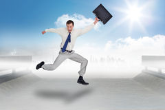 Composite image of cheerful jumping businessman with his suitcase Royalty Free Stock Image