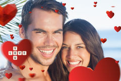 Composite image of cheerful loving couple having holidays Royalty Free Stock Images