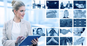 Composite image of cheerful stylish businesswoman using digital tablet Stock Photo