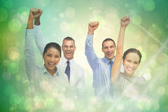 Composite image of cheerful work team posing with hands up Royalty Free Stock Images