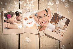Composite image of cheerful young couple enjoying a spa treatment. Cheerful young couple enjoying a Spa treatment against spa objects on wooden floor Royalty Free Stock Photo