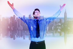 Composite image of cheering businessman with his arms raised up Stock Images