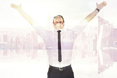 Composite image of cheering businessman with his arms raised up Royalty Free Stock Images