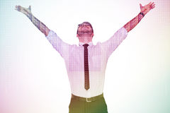 Composite image of cheering businessman with his arms raised up Royalty Free Stock Photos