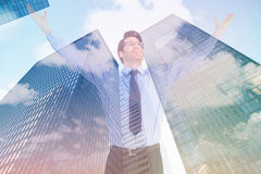 Composite image of cheering businessman with his arms raised up Stock Photography