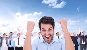 Composite image of cheering man looking at camera Royalty Free Stock Images