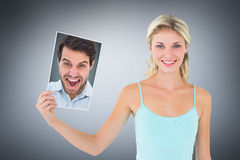 Composite image of cheering man looking at camera Stock Photo