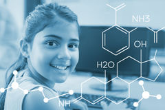 Composite image of composite image of chemical structure. Composite image of chemical structure against portrait of cute girl in computer class Royalty Free Stock Photos