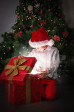 Composite image of child opening his christmas present Royalty Free Stock Photos