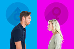 Composite image of childish couple having an argument Royalty Free Stock Photos