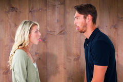 Composite image of childish couple having an argument Stock Photos