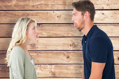 Composite image of childish couple having an argument Royalty Free Stock Images
