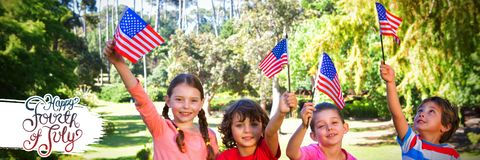 Composite image of children holding american flag royalty free stock photo