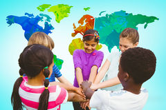 Composite image of children holding hands together at park Royalty Free Stock Photo