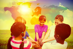 Composite image of children holding hands together at park Stock Photos