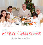 Composite image of children pulling a christmas cracker at home Royalty Free Stock Photo