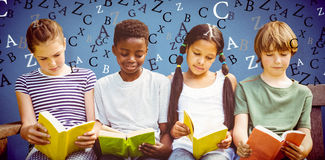 Composite image of children reading books at park. Children reading books at park against blue background stock photos