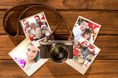 Composite image of children sitting with their family holding christmas boots Royalty Free Stock Photo