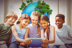 Composite image of children using digital tablet at park Royalty Free Stock Photo