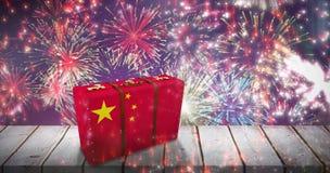 Composite image of chinese flag suitcase. Chinese flag suitcase against fireworks exploding over football stadium Stock Photo