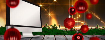 Composite image of christmas baubles Stock Image