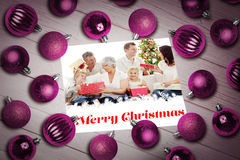 Composite image of christmas baubles on table royalty free stock photos