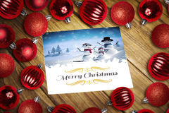 Composite image of christmas baubles on table Royalty Free Stock Image
