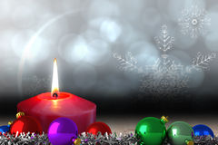 Composite image of christmas baubles and tinsel Stock Photos