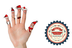Composite image of christmas caroler fingers Stock Image