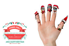 Composite image of christmas caroler fingers Stock Photography